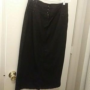 Long black jean skirt .
